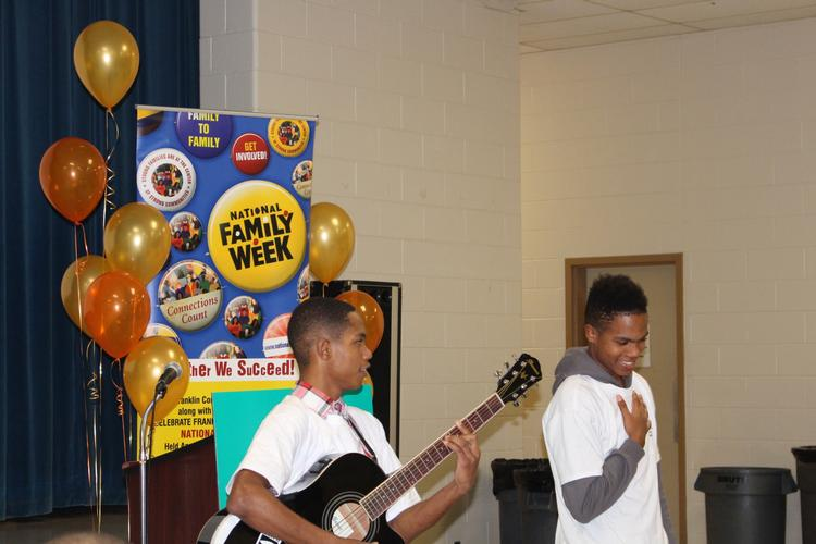 (From left) FCCS youth Denzel and Donell Warren-Albert perform during the National Family Week Celebration.